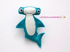 Cute miniature HAMMERHEAD SHARK magnet made from colorful felt fabric. This stuffed felt Hammerhead shark is originally designed as a great home decor or adorable gift for your loved ones, educational for kids, fun for all ages. The Hammerhead shark can be made as a magnet, double sided toy or hanging ornament. MAGNET. Basically it is a magnet - the Hammerhead shark have a strong magnet inside (you can not see the magnet from outside, it is safe for children) so you can put the item on…