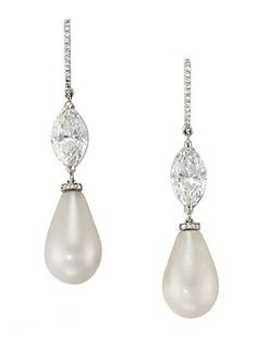 A FINE PAIR OF NATURAL PEARL AND DIAMOND EAR PENDANTS   Each designed as a pear-shaped pearl drop measuring approximately 15 by 9.38 mm and 14 by 9.23 mm to the marquise-cut diamond weighing 1.25 and 1.21 carats and pavé-set diamond half hoop top, 4.2 cm long