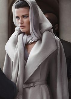 Donna Karan. That scarf and jacket, particularly in that color, looks like the perfect thing to cover up in on those days you just don't want to be seen. Wait... am I the only one who has days like that?