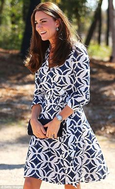 Royal blue: The Duchess looked her elegant self in a DVF batik print Patrice wrap dress