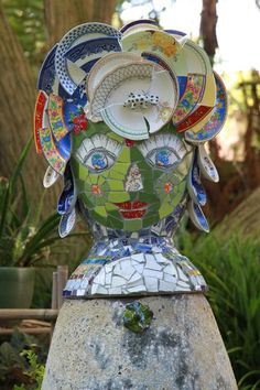 Tiled lady head w/plates as hats
