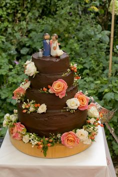 Four Tier Chocolate Wedding Cake with Miss Piggy Coral Rose Decor   A DIY back garden wedding in London   Rustic Decor   Coral Colour Scheme   Wedding Inspiration   Images by Gio Staiano Photography   http://www.rockmywedding.co.uk/corinna-daryl/