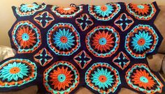 """From fan Amy Jo Bellis: """"Used Red Heart with Love  Finished!   Pattern can be found here: http://www.ravelry.com/patterns/library/crocheted-daisy-afghan"""""""