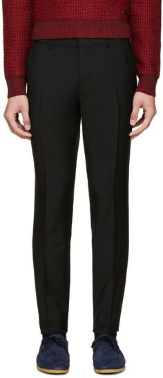 Burberry London  Black Wool Stirling Trousers  52596M000010 Slim-fit pleated wool trousers in black. Four-pocket styling. Unfinished hem at ankle cuffs. Tonal stitching. Zip-fly. 73% wool, 27% mohair. Made in Portugal.  $390