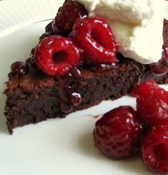 Flourless chocolate cake, spiced up with a hint of chili powder.  A silky, decadant texture…very moist and rich. Heaven!! Served with sweetened whipped cream, a simple raspberry sauce and fresh r…