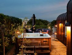 Rustic rooftop terrace hot tub. Yes please!
