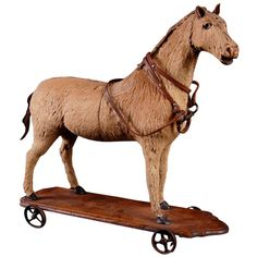 Rare French Antique Toy Horse, circa 1880 | From a unique collection of antique and modern toys at http://www.1stdibs.com/furniture/more-furniture-collectibles/toys/