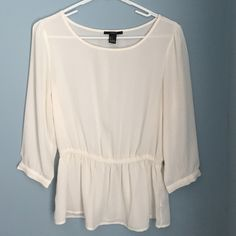3/4 sleeve peplum blouse Lovely blouse with an elastic around the waist and sleeves that button. Too small for me  no flaws Forever 21 Tops Blouses