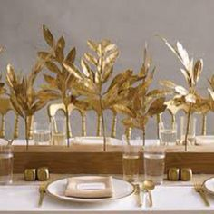 Spray paint fake leaves gold and post in wood blocks
