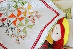 Pinwheel Doll Quilt- Colorful and fun, this small doll quilt makes a great blanket for your little one's dolls, and it saves you some money too.