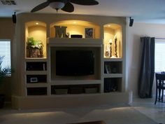 custom built in dry wall entertainment center with wall mounted flat screen TV and can lights. we still have to add the baseboard.