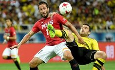 Schurrle's strike gives Dortmund 3-2 win in Japan