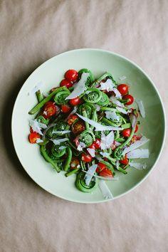 // Fiddlehead and Tomato Salad with Pecorino