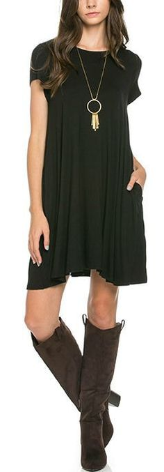 """Perfect Basic Black Tunic Dress in an ultra-soft Rayon/Spandex blend. Slight A-line fit with two front pockets. Small - 35"""" from shoulder to hem. Bust to 38"""". Medium - 36"""" from shoulder to hem. Bust t"""