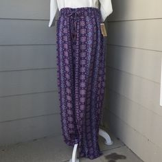 Drawstring pants America Vintage Blues Ladies pants with drawstring front to adjust the waist size. In the colors light blue, Maroon, Purple, White, and Dark Blue. Made by American Vintage Blues. American Vintage Pants Wide Leg