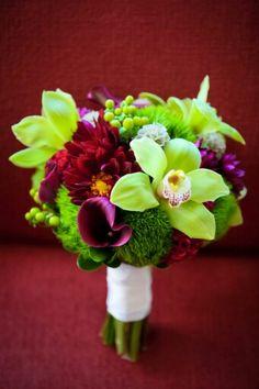 Lovely Wedding Bouquet Made Up Of: Cranberry & Purple Chrysanthemums,  Purple Calla Lilies, Hot Pink Coxcomb, Scabiosa Pods, Green Hypericum Berries, Green Cymbidium Orchids & Green Trick Dianthus
