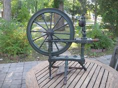 Norwegian spinning wheel, built in 1858, still in beautiful working condition. Has original green paint and hand-forged axle.