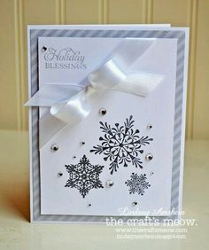 Lots of white. Snowflake stamps.