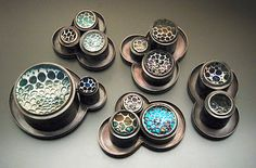 Looking lenses. Brooches with camera lenses magnifying the enamel and stones inside. LOVE. Michelle Startzman