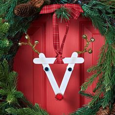 Help the little ones make this easy DIY Jingle Reindeer Door Hanger to decorate this holiday season.
