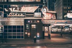 Photographer - Franck Bohbot. Captured over the course of almost two years, Bohbot's series called Light On comprises 57 nighttime photographs of classic New York City scenes.