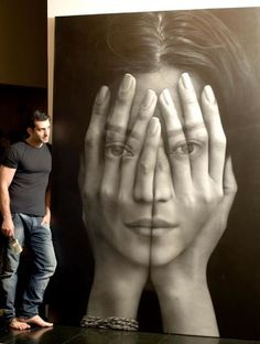 "07/17/2012 -TIGRAN  TSITOGHDZYAN ""Mirror"", 2011 - The Armenia-born painter, who currently lives and works in New York, has put into honing his craft has certainly paid off, allowing him to not only paint hyperrealistic renditions of people, but to peer into their souls with a few masterful layering techniques. ""Mirror"", a large-scale mural,  is part of Tsitoghdzyan's Millenium collection that criticizes the tech-reliant culture we live in, which he refers to as a ""technology renaissance."""