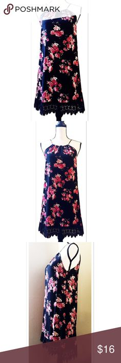 "Rue21 Floral Dress w/ Crochet Trimmed Hemline Pretty black and pink rose floral patterned dress featuring a 4"" long lacey crochet trimmed hemline, a adjustable neck tie, and a keyhole style back. Size medium. Measures approx. 34"" from the top of the dress down to the hem, 18"" across the front at the widest from seam to seam. Brand new, without tags. Never worn. Rue21 Dresses Midi"