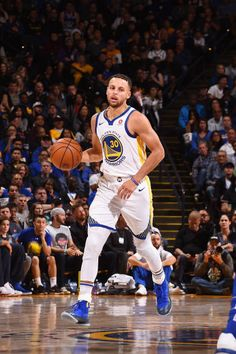 Stephen Curry of the Golden State Warriors handles the ball against the Philadelphia 76ers on November 11 2017 at ORACLE Arena in Oakland California...