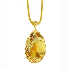 Extremely rare piece of landscape Baltic Amber in teardrop shape surrounded with 14ct gold handmade unique Floresca frame by S&A Jewellery Design