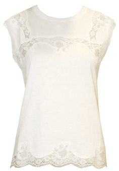 White Lace Top - Dolce & Gabbana  http://www.room7.co.uk/what-s-new/dolce-gabbana-white-t-shirt.html
