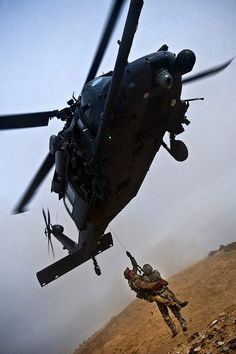A pararescueman hoists a survivor into an Pave Hawk during a terminal employment phase March at the Orchard Combat Training Center, Idaho. The hoist is a quick, effective method of recovering survivors. The phase is one out of a series. Military Helicopter, Military Jets, Military Aircraft, Military Weapons, Air Force Special Operations, Aviation World, Combat Training, Man Of War, Armed Forces