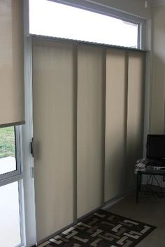 Sliding panels are a neat vertical treatment, great for patio doors and can even be used as a room divider!