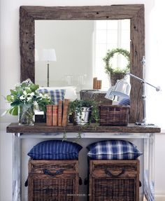 Like the baskets & large mirror. Might be able to tweak this a bit for my foyer minus the pillows & blue!