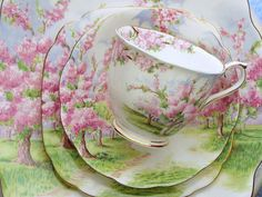 'Blossom Time' by Royal Albert.   Crown China stamp dates from 1933,   Description: gold trim, or green trim, Pink flowers, Apple Orchard   Cup Shape: Countess or Hampton