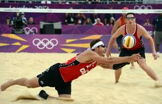 Martin Reader (L) of Canada makes a great save to go on to win as Joshua Binstock looks on against Great Britain during beach volleyball action held at Horse Guards Parade venue at the London 2012 Olympic Games in London England, July 28, 2012.