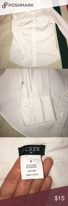 J. Crew white button down blouse size s This J. Crew button down is in perfect condition. A well tailored and fitted shirt with buttons on the cuffs and small pocket detail in the front. The shirt has a little stretch too it but not too much. Perfect for work or everyday wear! J. Crew Tops Button Down Shirts