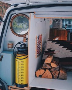 Setting up the wood in the van for a  quick and easy access . Just keep in mind to store and secure it before you drive away . During these wet and cold days we keep some dry firewood in the van. It's just so much easier to get a little campfire set up this way .