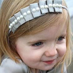 """Supplies: scrap of wide ribbon (about 2.5""""x11.5""""), elastic headband, pearls or buttons if you want, and a scrap of matching felt."""