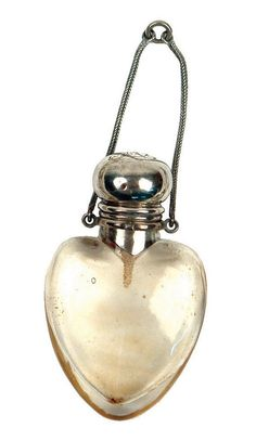 A late Victorian silver top glass heart form perfume bottle Birmingham 1900 by…