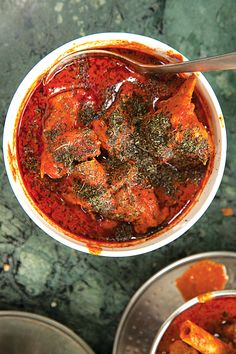 Tender lamb simmers in a fiery sauce in this recipe from Ahdoo's Hotel in Srinagar, Kashmir.