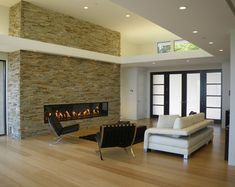 Modern fireplace wall tile fireplace stone wall tiles stone wall fireplace living room modern with modern . Fireplace Remodel, Fireplace Wall, Living Room With Fireplace, Fireplace Surrounds, Fireplace Design, Fireplace Stone, Basement Fireplace, Fireplace Ideas, Linear Fireplace