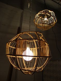 Hanging pendants made from stripped Cali Bamboo poles by Organic Light Sculptures