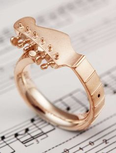Check out our Guitar Ring for music lovers. Customize it it the metal you love!