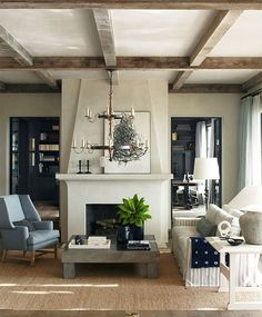 Coffered Beamed Ceiling, Muted Black Doors and Built In Bookcases Mediterranean dwelling overlooks Salt Creek Beach
