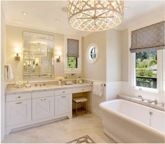 Love the marble, the vanity, the mirror, the chandelier, the roman shades, the tub...