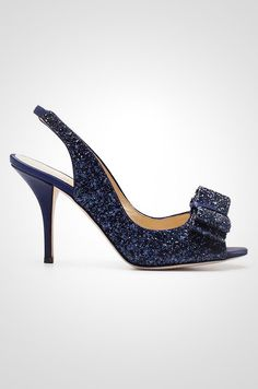"Kate Spade's glittering navy Charm shoe, with a peep toe and bow detail, makes for an unforgettable ""something blue"" for any bride."