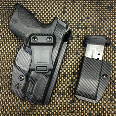 Wraith Holster and Single MP for the Smith and Wesson Shield in carbon fiber black. Smith & Wesson Bodyguard, Smith And Wesson Shield, Smith N Wesson, S&w Shield, Kydex Holster, Home Protection, Concealed Carry, Self Defense, Cool Walls