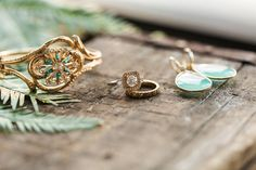 Midcentury bangle, aqua chalcedony earrings, and two toned wedding set.  Photo by Jessica Cooper Photography