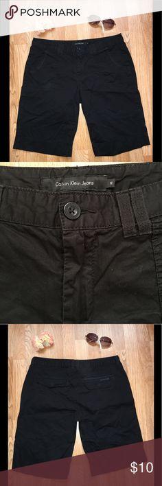 "Calvin Klein Women's Black Bermuda shorts No flaws; Size 12; belt loops; 4 pockets; waist laying flat = 18"" across ; front rise = 10"" ; inseam = 12"" Calvin Klein Shorts Bermudas"