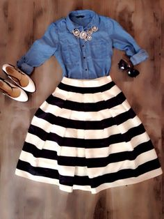 Tuck a denim shirt a a flirty striped full skirt and top off the look with a statement necklace for a chic spring look